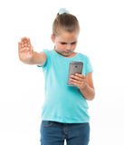 Little girl holding cell phone Royalty Free Stock Photography