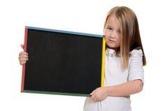 Little girl holding chalkboard Royalty Free Stock Photo