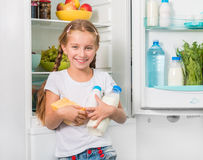 Little girl holding cheese and milk Royalty Free Stock Photos