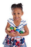 Little girl holding chocolate easter eggs stock photo