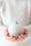 Little girl holding a christmas ball Royalty Free Stock Photography