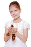 Little girl holding Christmas decoration Royalty Free Stock Photo