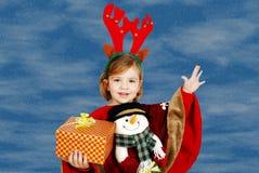Little girl holding Christmas gift Stock Photo