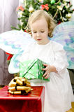 Little girl holding christmas gift Stock Photography
