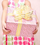 Little girl holding christmas gift box in the foreground Stock Photography