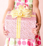 Little girl holding christmas gift box in the foreground Stock Images