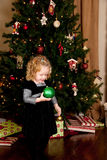 Little Girl Holding Christmas Ornamet Royalty Free Stock Images