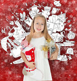 Little girl holding Christmas presents and doodle background with lots of toys Stock Photo