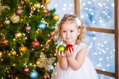 Little girl holding a Christmas toy Stock Photos