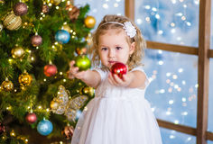 Little girl holding a Christmas toy Stock Photography
