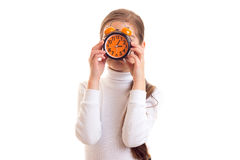 Little girl holding a clock Royalty Free Stock Photo