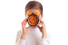 Little girl holding a clock Royalty Free Stock Image
