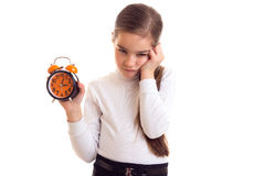 Little girl holding a clock Stock Photography