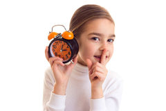 Little girl holding a clock Stock Photo
