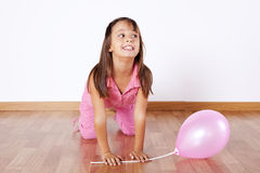 Little girl holding color ballons Stock Images