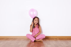 Little girl holding color ballons Royalty Free Stock Image