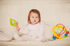 Little girl holding colored books royalty free stock image