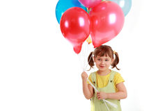 Little girl holding colorful balloons Royalty Free Stock Images