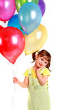 Little girl holding colorful balloons Royalty Free Stock Photography