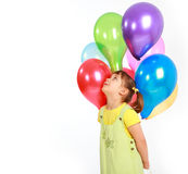Little girl holding colorful balloons Royalty Free Stock Image