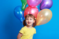 Little girl holding colorful balloons Royalty Free Stock Photos