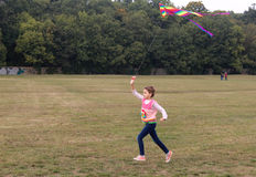 Little girl holding colorful kite Stock Photos