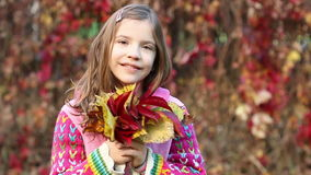 Little girl holding colorful leaves autumn season stock video footage