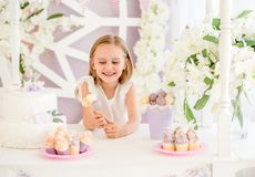 Little girl holding colorful sweet lollipops in the candy bar royalty free stock image