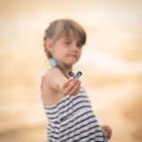 Little girl holding a conch shell. Girl holding a conch shell Stock Photography