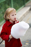 Little girl holding cotton candy Stock Image