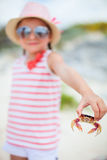 Little girl holding a crab Stock Image