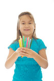 Little girl holding crayons Stock Photo