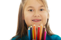 Little girl holding crayons Royalty Free Stock Images
