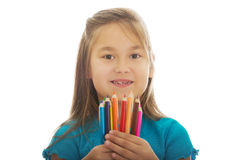 Little girl holding crayons Stock Image