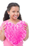 Little girl holding cushion in the shape of a heart Royalty Free Stock Photos