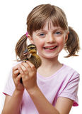 Little girl holding a cute duckling Stock Photo