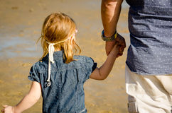 Little girl holding Daddy's hand Royalty Free Stock Images