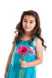 Little girl holding daisies Stock Photos