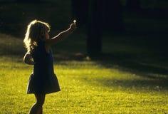 Little girl holding a dandelion Stock Photo