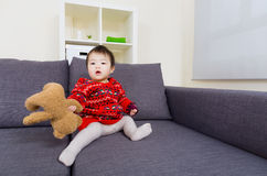 Little girl holding doll bear Royalty Free Stock Photos