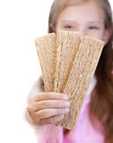 Little girl holding dry bread Stock Photos