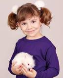 Little girl holding dwarf bunny Stock Image