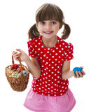 Little girl holding easter eggs in a basket Stock Photos
