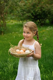Little girl holding eggs Royalty Free Stock Photos