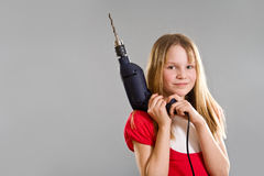 Little girl holding electric drill Stock Photos