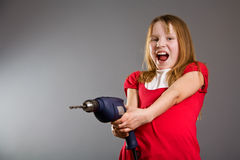 Little girl holding electric drill Stock Images