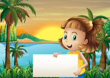 A little girl holding an empty signage Royalty Free Stock Photo