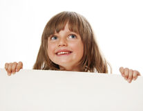 Little girl holding empty white board Royalty Free Stock Images