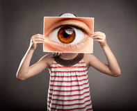 Little girl holding an eye Stock Images