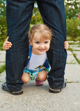 Little girl holding the feet of parents Stock Photos